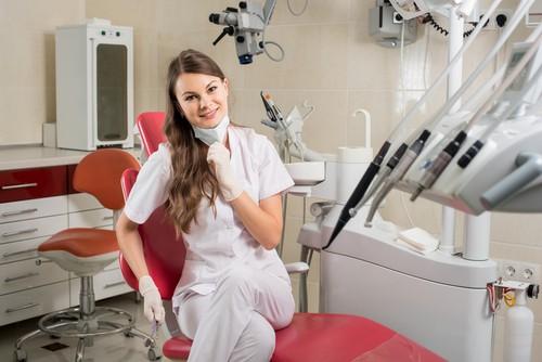 dental hygienest in dental chair
