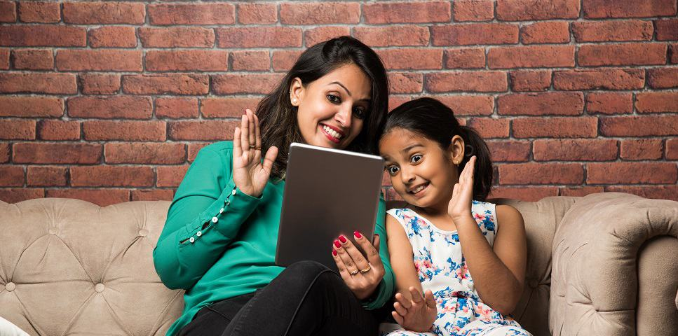 Indian girl and mom doing zoom meeting